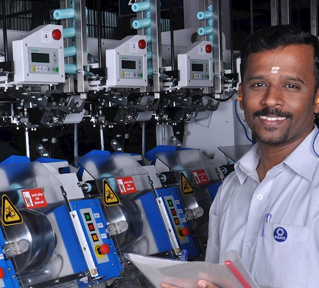 Man in front of factory machinery